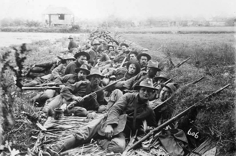 American soldiers of the 20th Kansas in trenches in the Philippines during the insurrection. Note the open baked beans can in the left foreground. Photo from the Library of Congress.